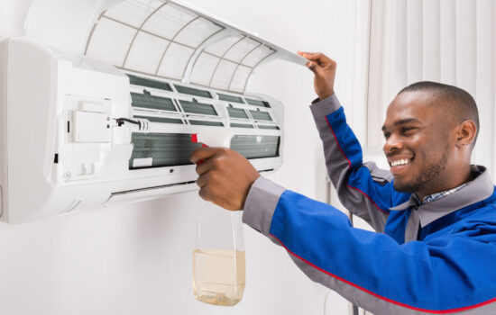 man cleaning air conditioner