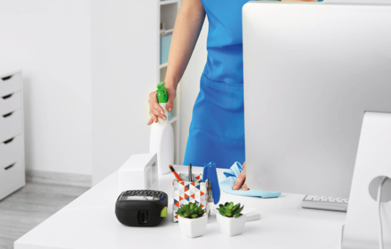 woman cleaning computer desk